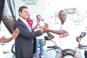 mr-sameer-musale-astarc-motors-director-hands-over-keys-to-musa-lule-the-winner-of-one-of-the-hero-motorcycles-that-were-given-out-to-bodaboda-cyclists-during-the-launch